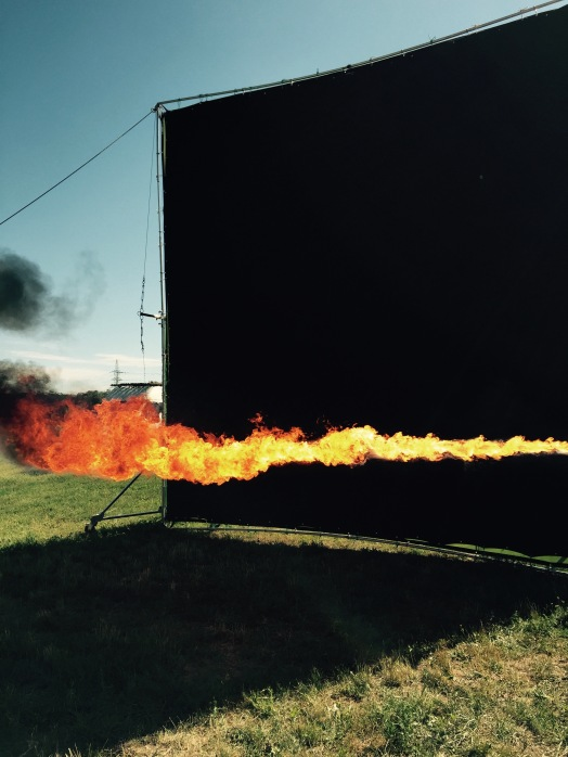 we shoot flames against black screens to later use them for the dragon.