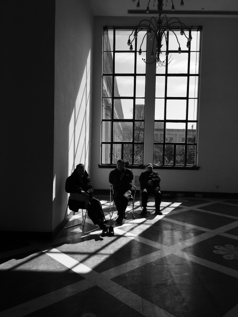 workers inside an empty museum